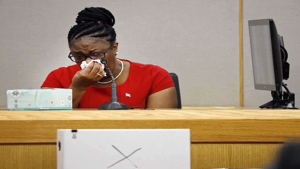 Botham Jean's mother, Allison Jean, cries while speaking about her son during sentencing testimony for former Dallas Police Officer Amber Guyger in 204th District Court at the Frank Crowley Courts Building in Dallas, Tuesday, Oct. 1, 2019. (Tom Fox/The Dallas Morning News via AP, Pool)