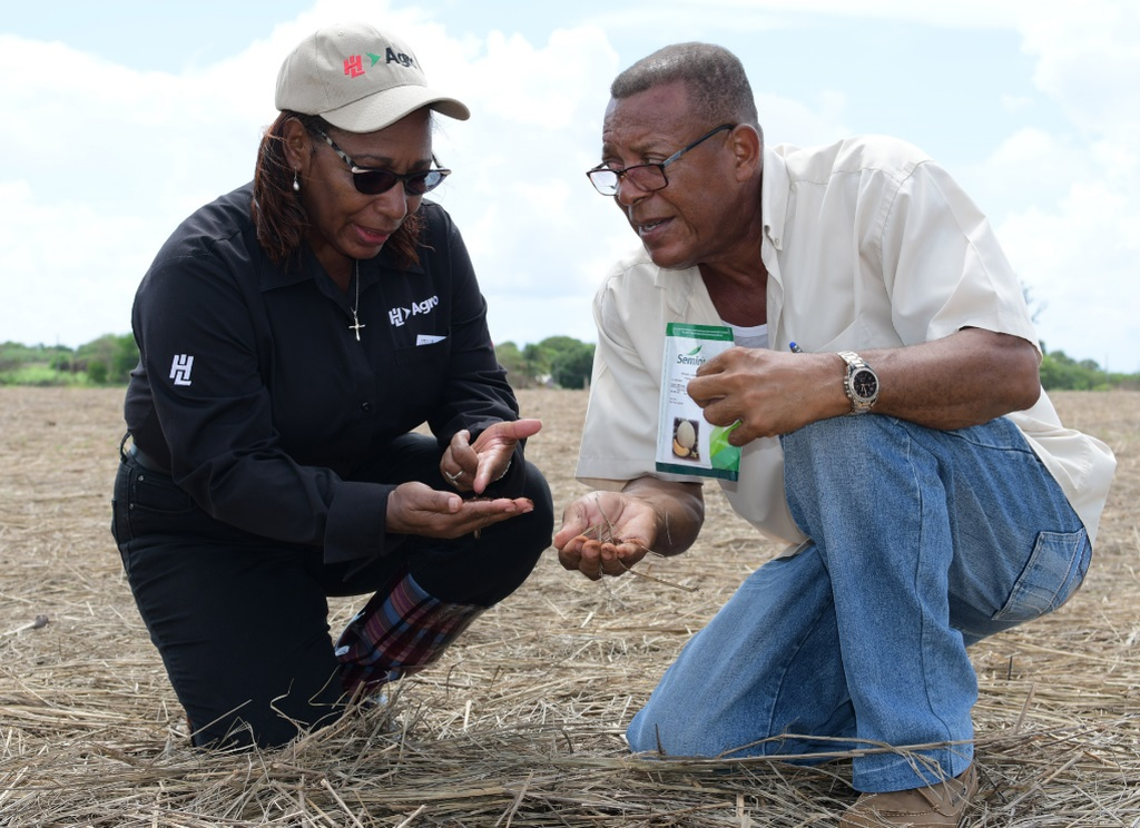 Deputy Chief Executive Officer, Olive Downer Walsh of Hardware and Lumber Limited, talks with melon farmer Vernon Reynolds who was one of the 40 farmers that suffered losses.
