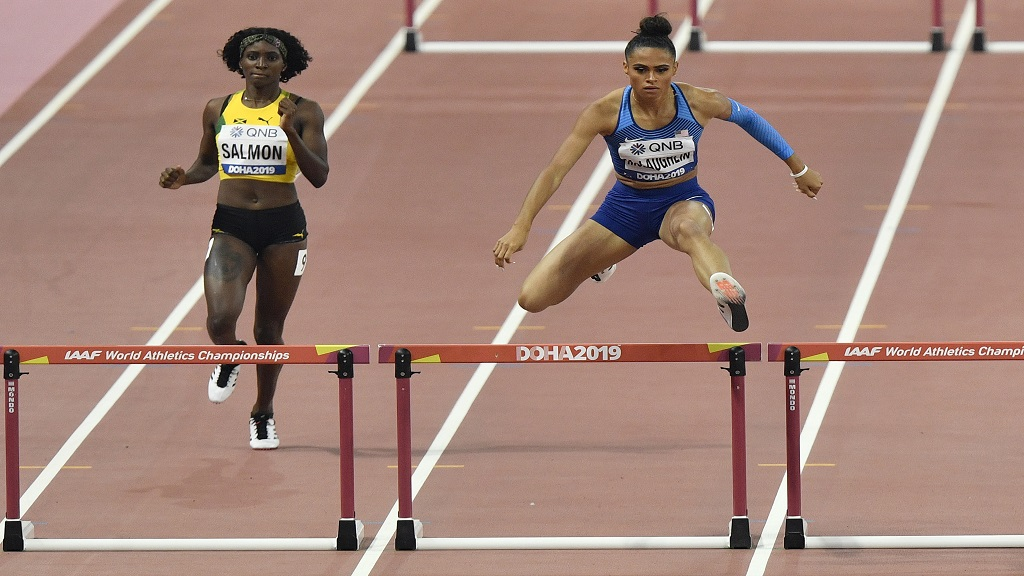 Sydney Mclaughlin, of the United States, and Shiann Salmon, of Jamaica, left compete in the women's 400m hurdle heats at the World Athletics Championships in Doha, Qatar, Tuesday, Oct. 1, 2019. (AP Photo/Martin Meissner).