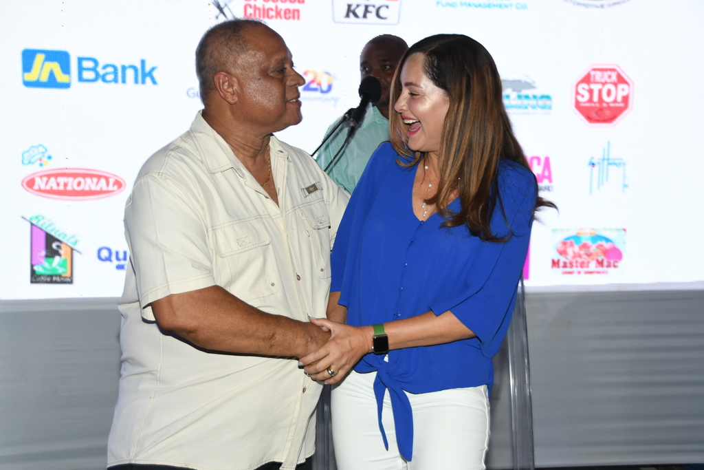 Max Rochester (left), chair of the Sir Henry Morgan Angling Association makes a point to Member of Parliament for East Portland, Ann-Marie Vaz, during the launch of the Port Antonio Marlin Tournament at Truck Stop in Market Place, St Andrew in late August.