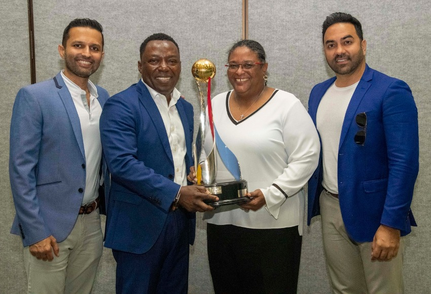 Local owners of the Barbados Tridents (left to right) Kailash Pardasani, Terrol Cummins and Arvind Gopwani, pose with Prime Minister Mottley. (Prime Minister's Office)