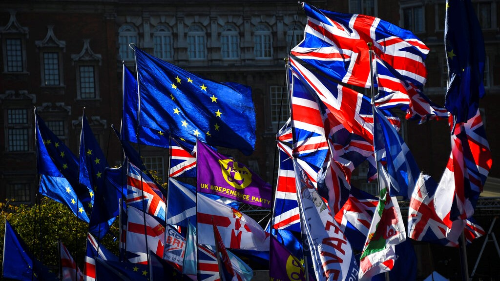 EU and Union flags flap outside the Houses of Parliament in London, Monday, October 28, 2019. (AP Photo/Alberto Pezzali)
