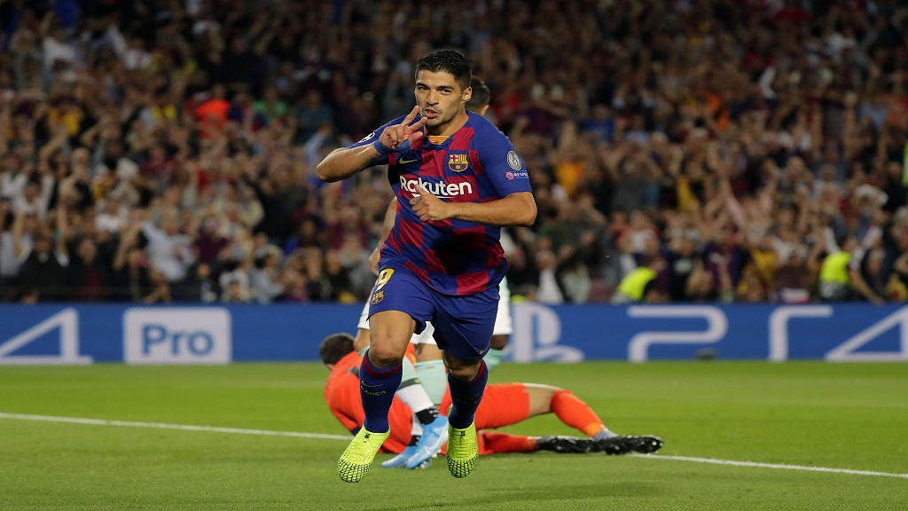 Barcelona's Luis Suarez celebrates after scoring his side's second goal during the group F Champions League football match against Inter Milan at the Camp Nou stadium in Barcelona, Spain, Wednesday, Oct. 2, 2019. (AP Photo/Emilio Morenatti).