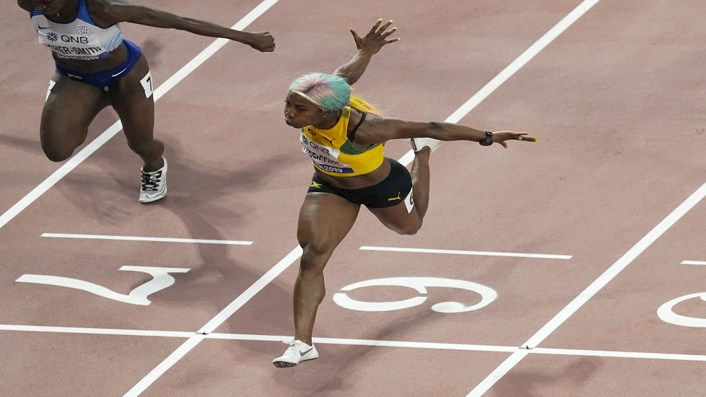 Shelly-Ann Fraser-Pryce (right) beats Great Britain's Dina Asher-Smith to win women's 100m final at the IAAF World Athletics Championships in Doha, Qatar on September 29, 2019.