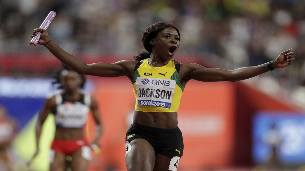 Jamaica's Shericka Jackson celebrates after leading the team to the gold medal in the women's 4x100m relay final at the World Athletics Championships in Doha, Qatar, Saturday, Oct. 5, 2019. (AP Photo/Petr David Josek).