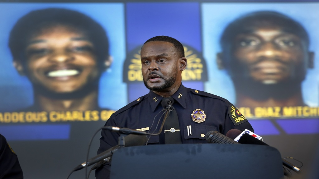 Dallas Assistant Chief of Police Avery Moore addresses the media about a drug deal gone bad resulting in the death of Joshua Brown. (Tom Fox/The Dallas Morning News via AP)