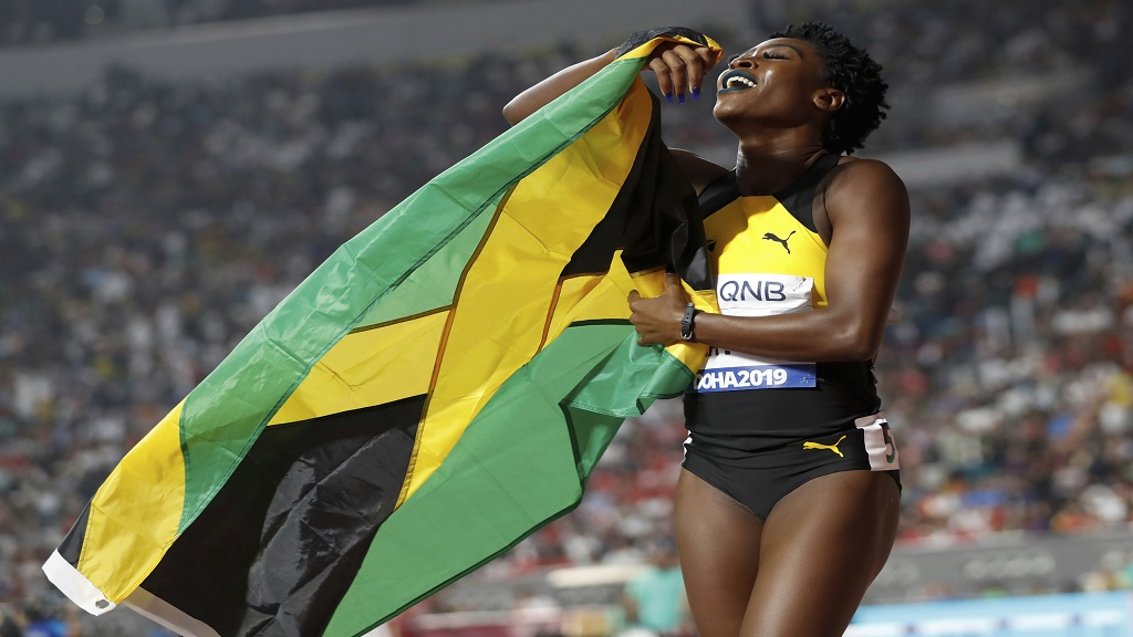 Rushell Clayton of Jamaica the bronze medal winner celebrates after the women's 400m hurdles final at the World Athletics Championships in Doha, Qatar, Friday, Oct. 4, 2019. (AP Photo/Petr David Josek).