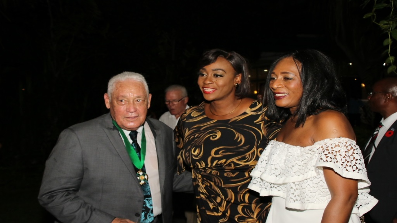 Mike Henry and wife, Dawn (right), along with Juliet Holness, wife of Prime Minister Andrew Holness, share in the happy occasion of a reception in honour of Henry receiving the Order of Jamaica on National Heroes' Day, at the gardens of the Pegasus Hotel in New Kingston on Monday evening.