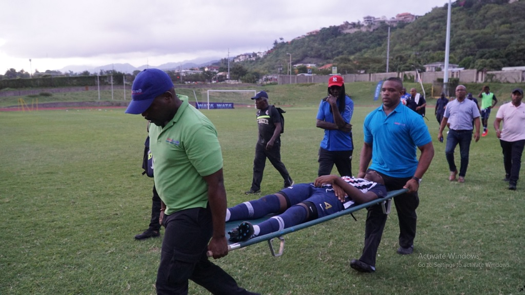 Jamaica College player Terrence Francis being stretchered off the field of play at a Manning Cup football match against Wolmer's Boys' School at Stadium East in St Andrew on Monday afternoon, after a lightning strike during the game. (Photos: Job Nelson/Marlon Reid)