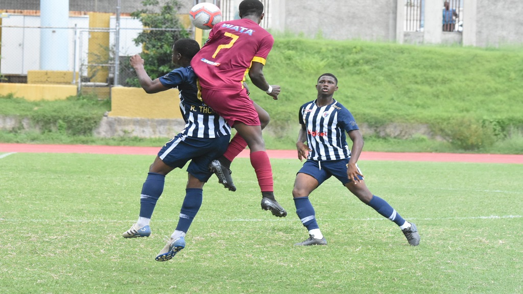 Revaldo Mitchell of Wolmer's (right) and JC's Richard Thompson (left) challenge for an aerial ball during the remaining eight minutes of their top-of-the-table Manning Cup  match at Stadium East on Wednesday, October 16.  JC finished atop the group after a 4-0 victory at Jose Marti on Friday, while Wolmer's had to settle for second place following a 2-2 draw at Vauxhall High. (PHOTO: Marlon Reid).