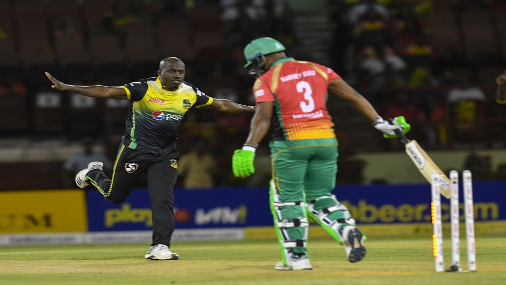 Derval Green (left) of Jamaica Tallawahs celebrates the dismissal of Chanderpaul Hemraj of Guyana Amazon Warriors during match 29 of the Hero Caribbean Premier League at Guyana National Stadium on October 3, 2019 in Providence, Guyana. (Photos by Randy Brooks - CPL T20/Getty Images).