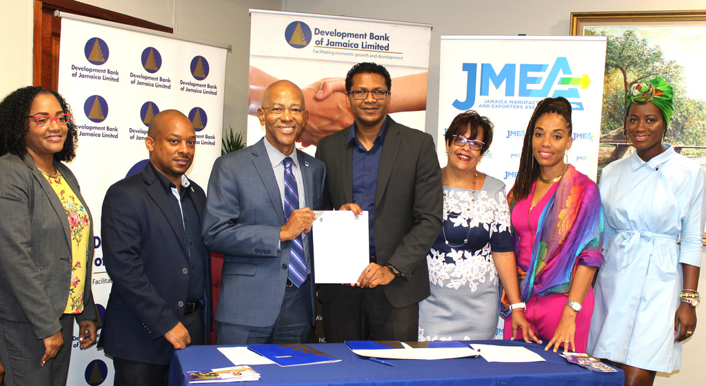 From left: Development Bank of Jamaica (DBJ) Manager of Portfolio Management Claudia Andrews, General Manager of Loan Origination and Portfolio Management Edison Galbraith and Managing Director Milverton Reynolds, JMEA President Richard Pandohie, Vice President Michelle Smith, Executive Director Imega Breese McNab and Export and Domestic Policy Research and Information Manager D'Jamila Ward at DBJ's offices on Wednesday.