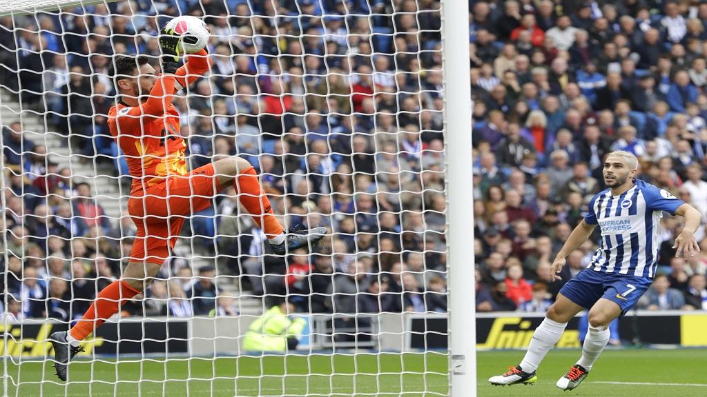 Tottenham's goalkeeper Hugo Lloris makes a save during the English Premier League football match against Brighton at Falmer stadium in Brighton, England Saturday, Oct. 5, 2019. (AP Photo/Kirsty Wigglesworth).