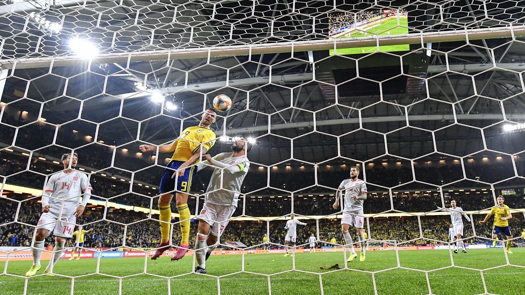Sweden's Marcus Berg scores the opening goal during the Euro 2020 Group F qualification football match against Spain at Friends Arena in Solna, Stockholm, Sweden, on Tuesday Oct. 15, 2019. (Anders Wiklund/ TT via AP).