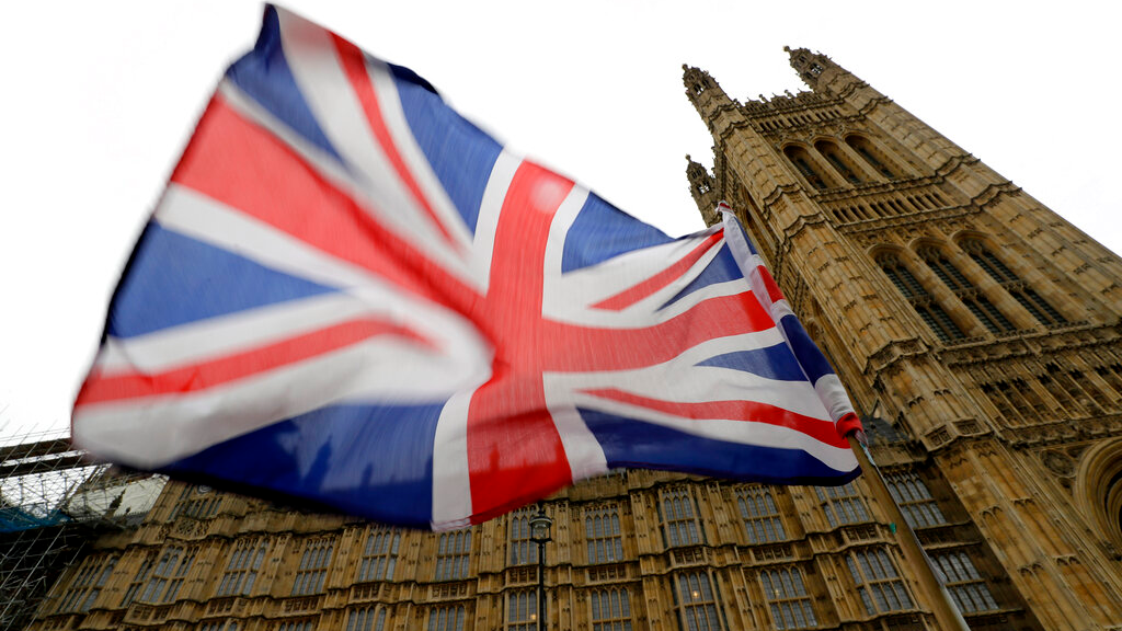 A Union flag flies in front of Parliament in London, October 25, 2019. Politicians in Britain and the European Union seem to be looking to each other to break the Brexit deadlock. (AP Photo/Kirsty Wigglesworth)