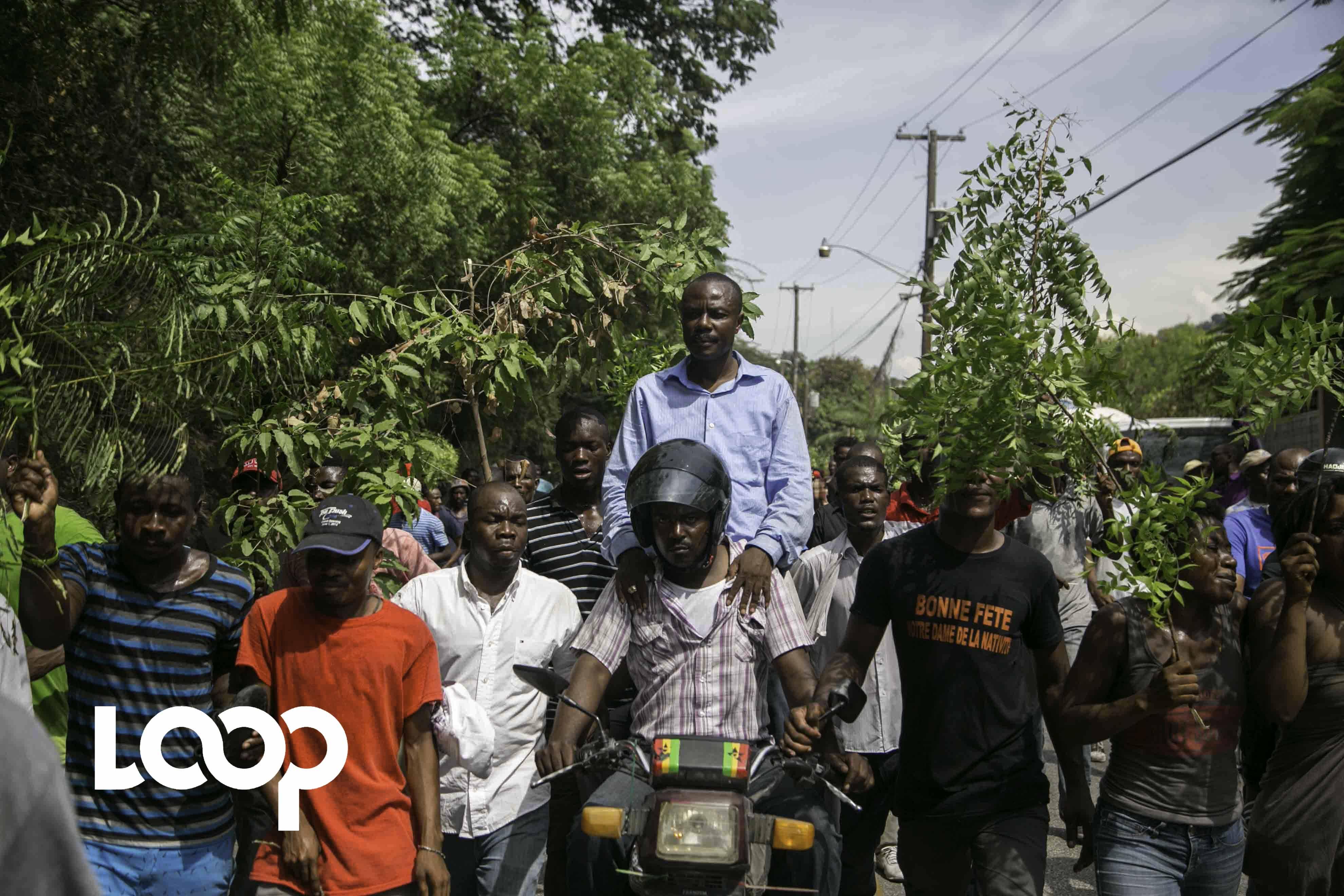 Jean Charles Moïse lors d'une manifestation à Port-au-Prince