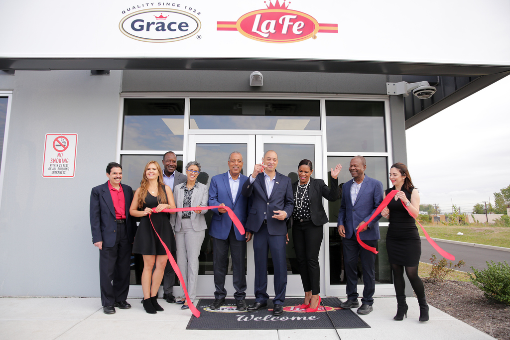GraceKennedy Group CEO, Don Wehby (centre) beams with pride after cutting the ribbon to signal the official opening of GraceKennedy USA's new multi-purpose facility in Woodbridge, New Jersey. Joining in the celebration are (l-r) GraceKennedy Group CFO and Director, Andrew Messado; GKUS  CEO, Derrick Reckord; GK Director, Gina Phillipps Black; GK Chairman, Prof Gordon Shirley; GK International Foods  CEO, Andrea Coy, and GK Director, Everton McDonald, assisted by members of an external promotional team.