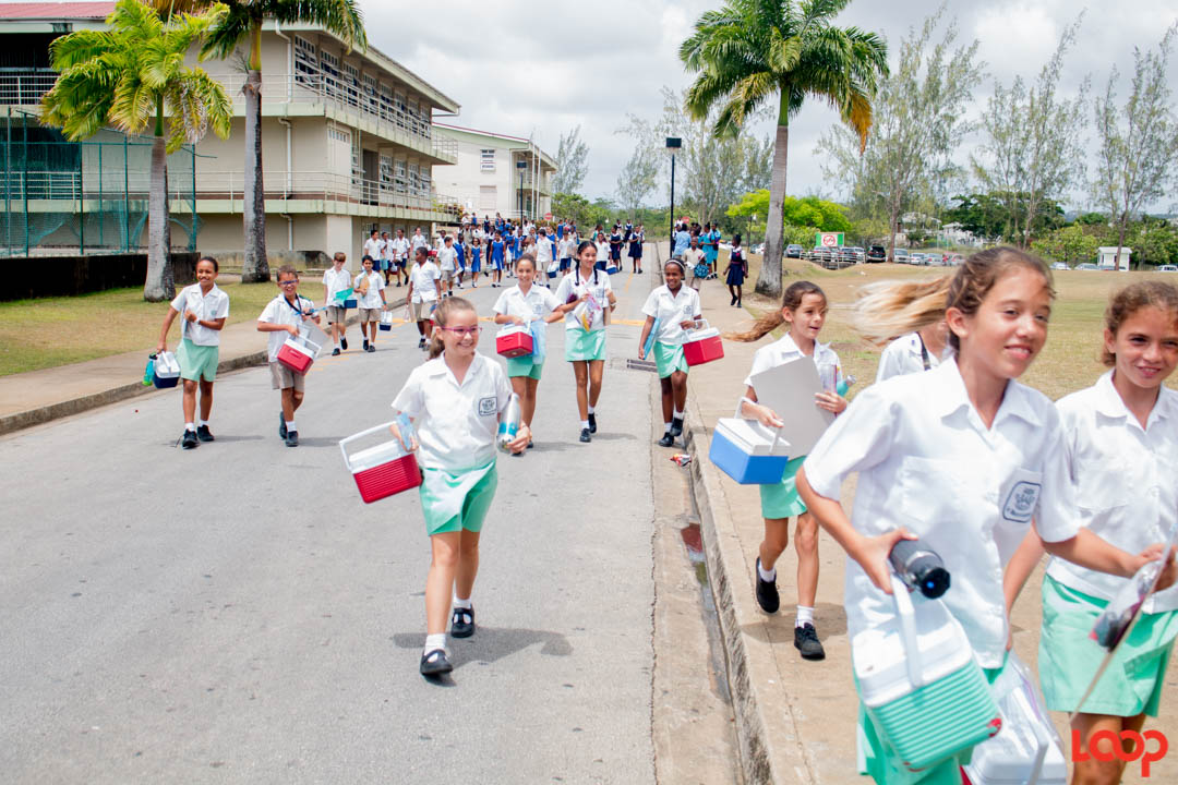 Students of St. Winifred's who sat at the Lester Vaughan Secondary School happily going to greet their parents after the exam.