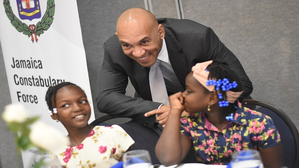 Commissioner of Police Major General Antony Anderson with Danielle Pinnock (left) and Jayhanna Jackson at the Jamaica Constabulary Force's luncheon for children of fallen officers at the Jamaica Pegasus hotel in St Andrew. (Photos: Marlon Reid)