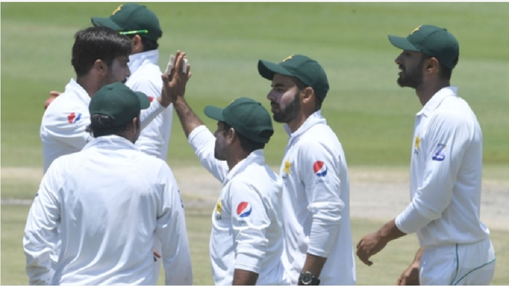 Pakistan celebrate a Hasan Ali wicket.
