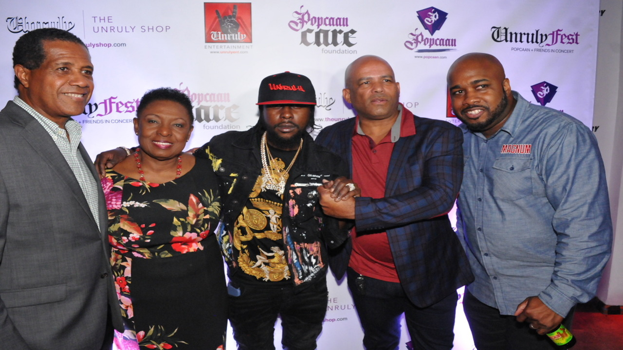 Unruly Fest promoter Popcaan (centre) with (from left) Factories Corporation of Jamaica chairman Lyttleton Shirley; Entertainment Minister Olivia Grange; Western St Thomas MP James Robertson and Magnum Tonic Wine brand manager Mark Telfer.