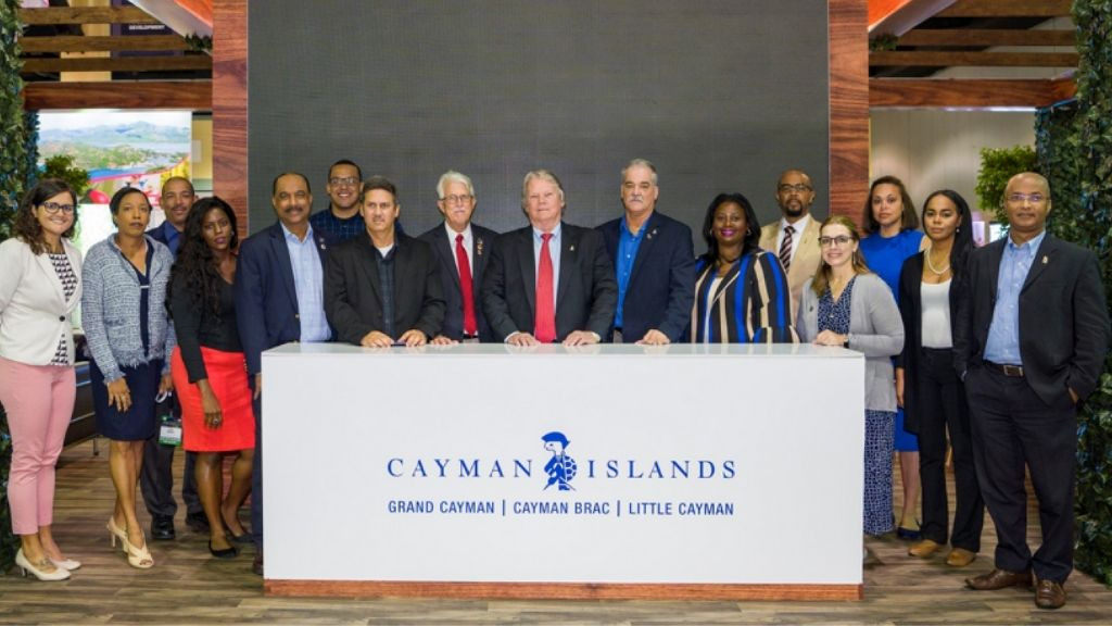 The Cayman delegation included the Hon. Min of Tourism Moses Kirkconnell (centre); along with senior civil servants, industry partners and representatives of the Department of Tourism.