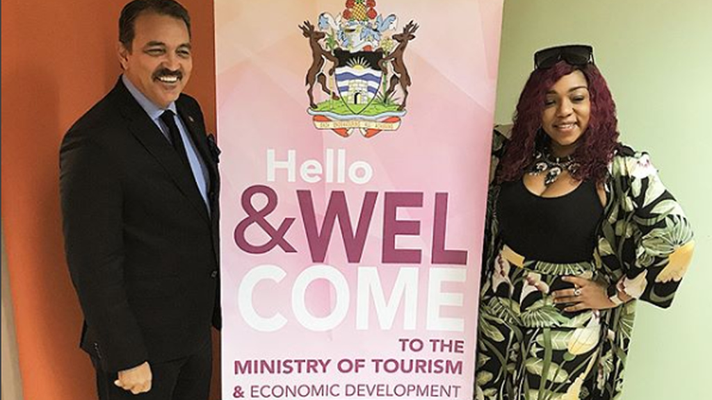 Destra Garcia with Antigua's Minister of Tourism Charles Max Fernandez.
