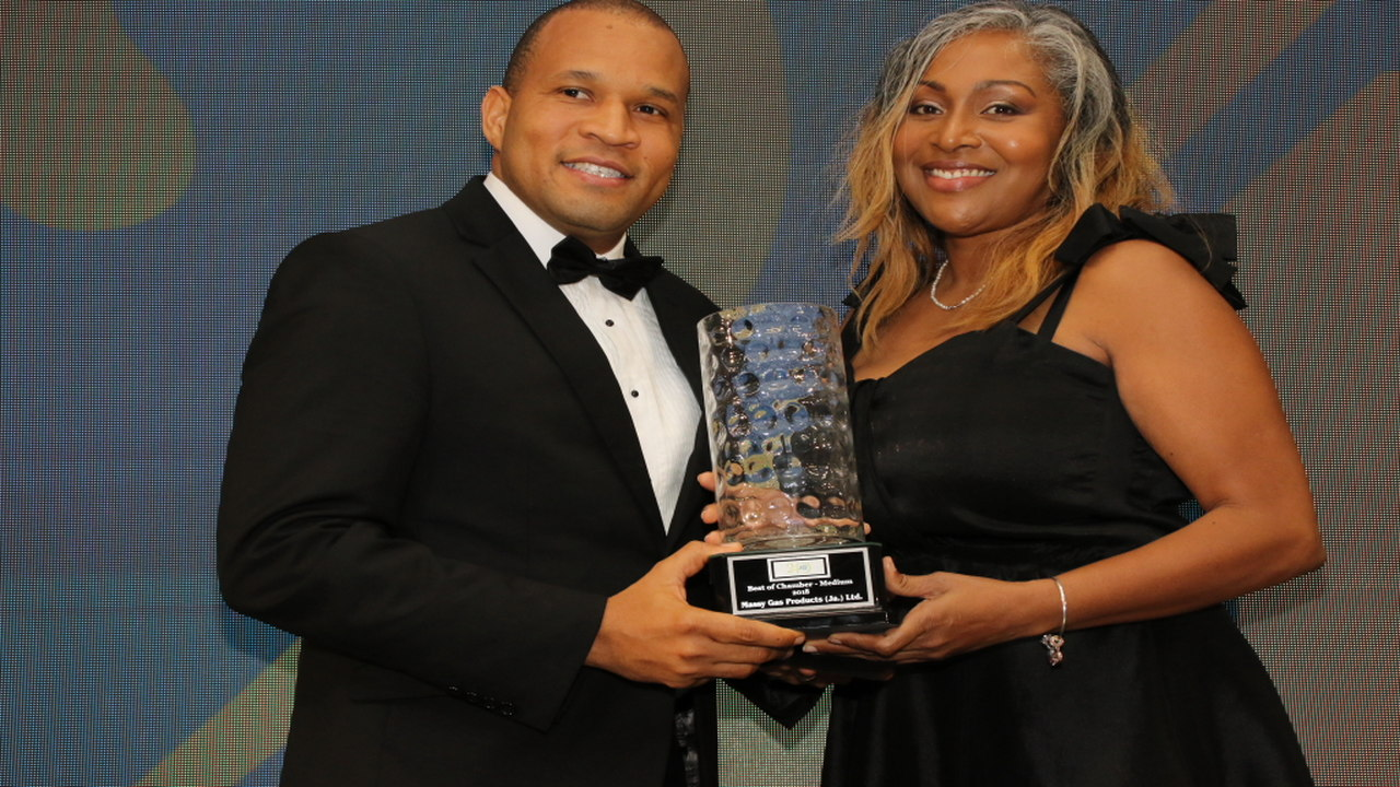 Rohan Ambersley, CEO Massy Gas Products receives the Best of Chamber, Medium award from Phadra Saunders, Director, People, Flow Jamaica & Cayman.