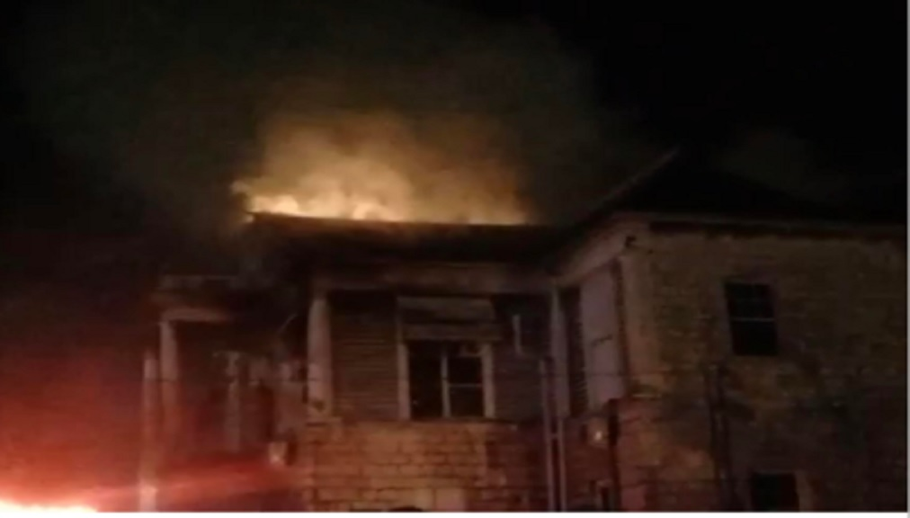 A screen grab from a video recording of the Mandeville Courthouse building on fire on Thursday morning.