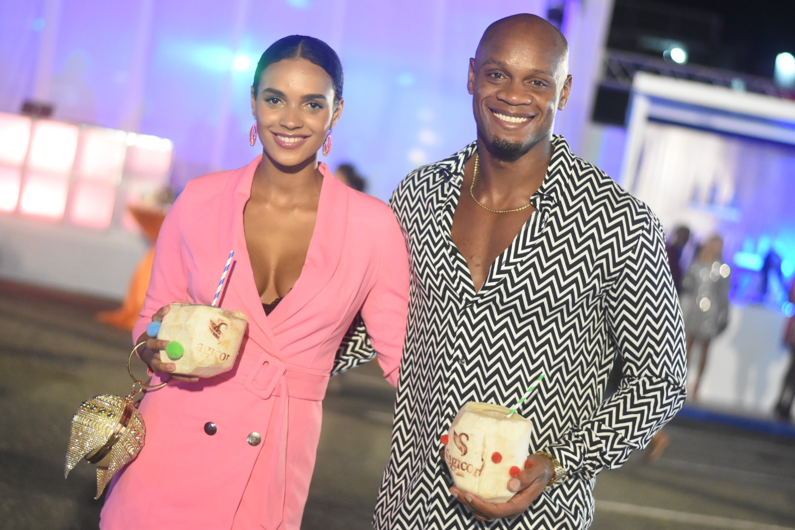 Alyshia and Asafa Powell enjoy coconut water from the Sagicor Coconuts booth. (Photos: Marlon Reid)