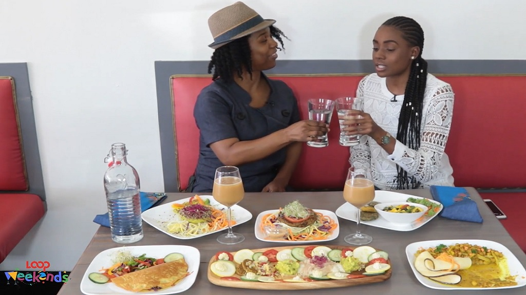 Shanique (right) and Living Foods and Juices operator, Kerry Coote, share a toast.