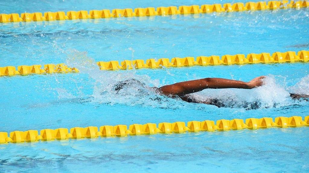 Zaneta Alvaranga in action at the Dean Martin Memorial Swim Meet.