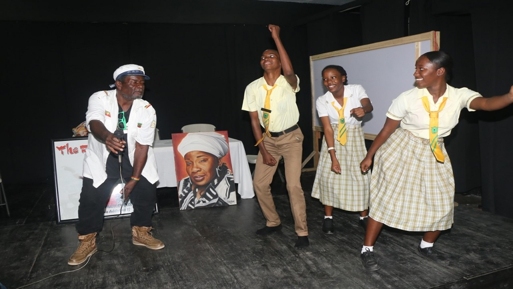 Bongo Herman and students doing the ska at a Rita Marley Foundation music workshop held at Edith Dalton James High School in St Andrew last week.