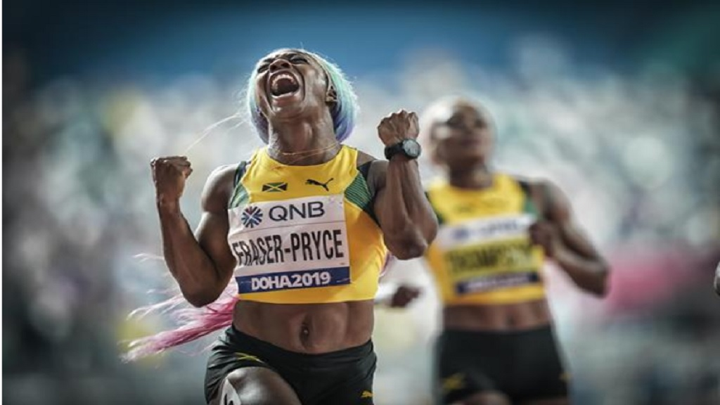 Shelly-Ann Fraser-Pryce celebrates her gold medal in Doha.