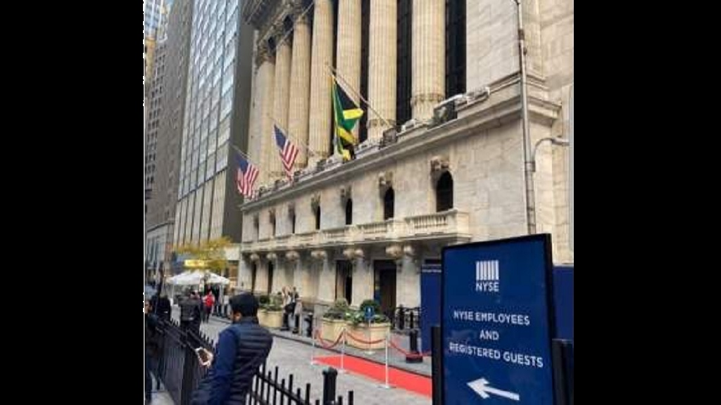 The Jamaican flag flies high alongside that of the United States at the New York Stock Exchange building on Wednesday, in recognition of the Jamaica Stock Exchange being the top performing stock market in the world in 2018.