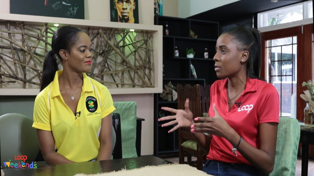 Shanique chats with Reggae Mill co-owner Orlease King (right).