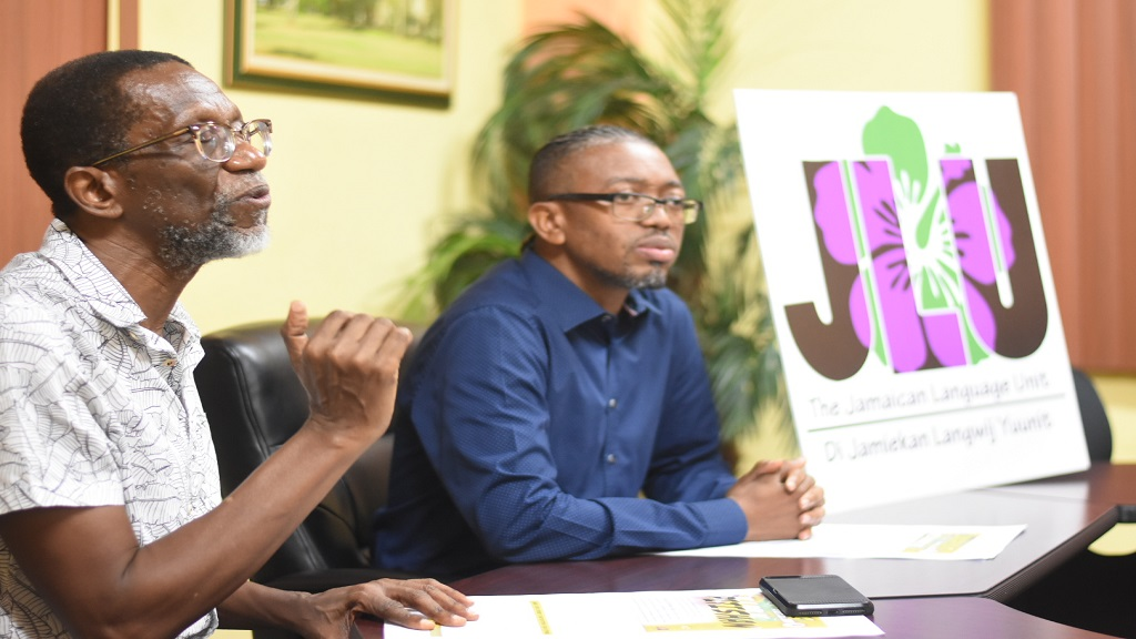 Professor Emeritus Hubert Devonish (left) of the Jamaica Language Unit (JLU) makes a point as he addresses journalists at a press conference on Thursday. Seated beside him is head of the JLU, Dr Joseph Farquharson. (Photo: Marlon Reid)