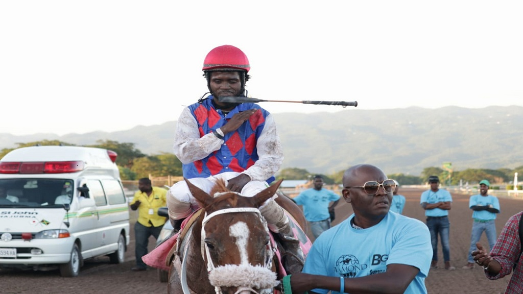 Jockey Robert Halledeen guides WILL IN CHARGE to the winners' enclosure after the 5-year-old chestnut horse won the Diamond Mile by a short head at Caymanas Park on Saturday, December 1, 2018 (PHOTO: Shawn Barnes).