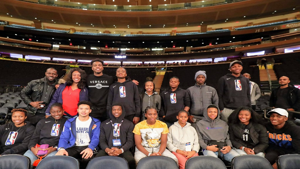 Bahamian basketball player, Buddy Hield (back row, 3rd left) of the Sacramento Kings spent some time with the Digicel NBA Jumpstart participants when they went to watch the Sacramento Kings vs New York Knicks at Madison Square Gardens, New York.