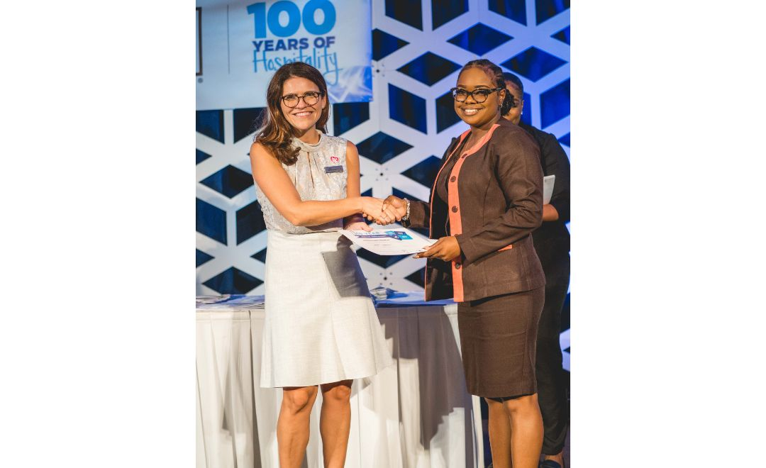 Hilton Barbados Resort's General Manager Tammy LeBlanc (left) presenting Finance Department's Kerrieann Francis with her Long-standing award.