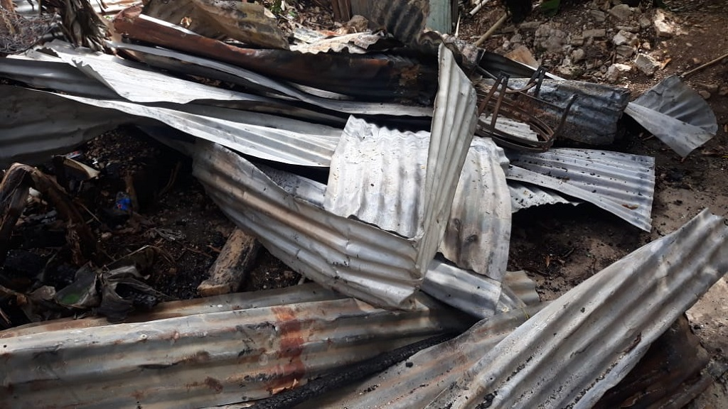 The remains of a one-bedroom board house in which two young children perished in Norwood, St James late on Friday night.