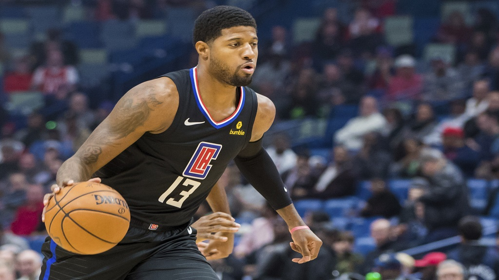 Los Angeles Clippers forward Paul George (13) dribbles down the court against the New Orleans Pelicans in the first half of an NBA basketball game in New Orleans, Thursday, Nov. 14, 2019. (AP Photo/Sophia Germer).