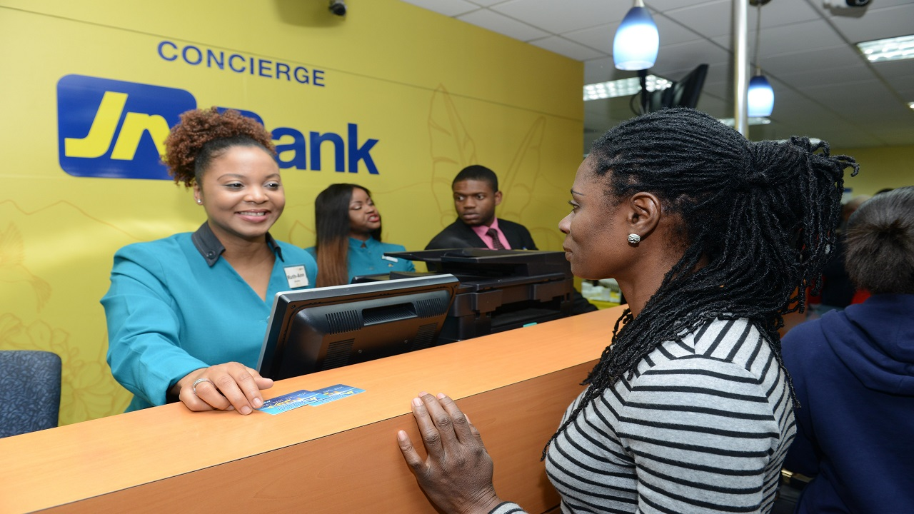 A representative of JN Bank assists a customer at the company's Half-Way-Tree branch in Kingston. (File photo)
