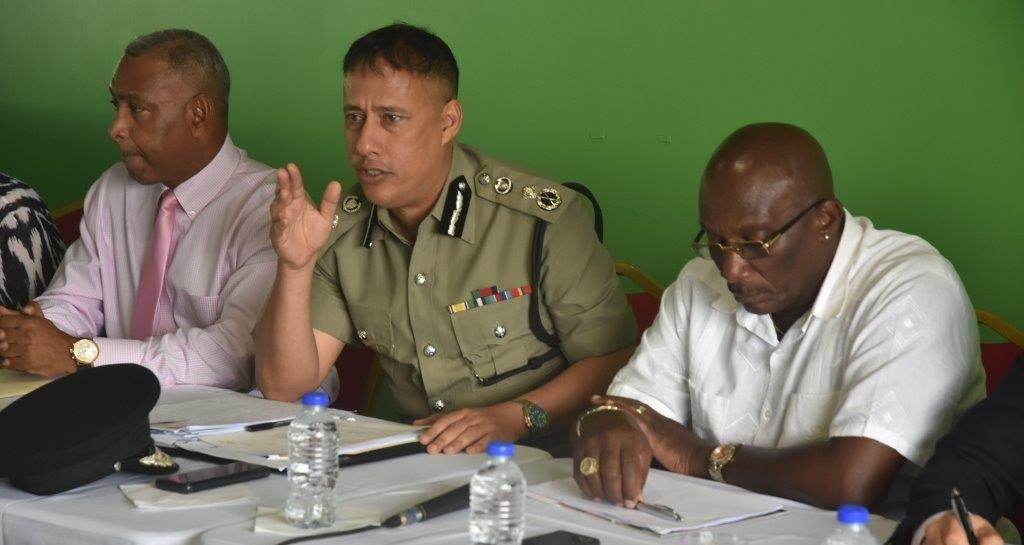 Police Commissioner Gary Griffith (centre), NCC Chairman Winston 'Gypsy' Peters (right).