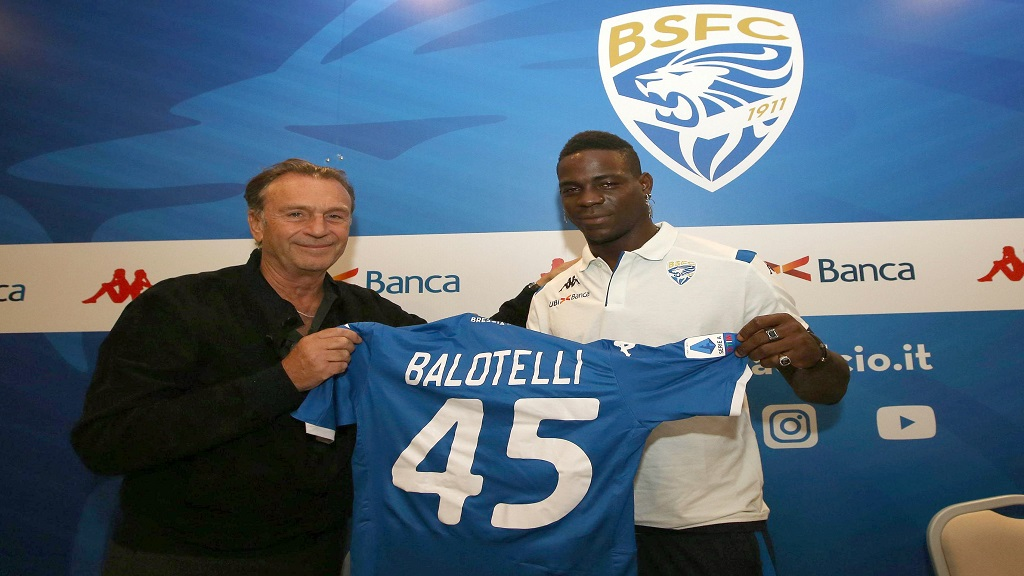 In this Monday, August 19, 2019 file photo, Brescia's president Massimo Cellino, left, holds a  jersey with football player Mario Balotelli during a press conference in Brescia, Italy. Cellino has made an apparently racist remark about his own club's forward Balotelli. (Filippo Venezia/ANSA via AP, File )