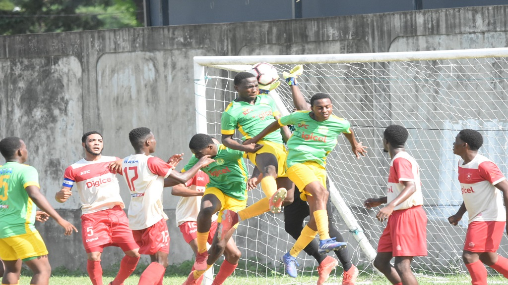 St Jago High's defenders challenge for an aerial ball against Mona High during their ISSA/Digicel Walker Cup first round fixture at Prison Oval in Spanish Town on Friday, November 8, 2019.  Mona won 2-0. (PHOTOS: Marlon Reid).