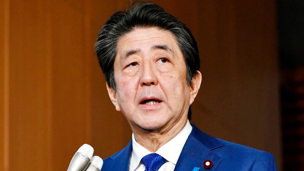 Japan's Prime Minister Shinzo Abe speaks to media about the projectiles that North Korea launched November 28, 2019, in Tokyo. (Kyodo News via AP)