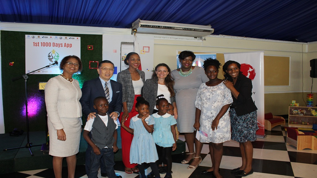 (From left) ECC's Karlene DeGrasse-Deslandes; Japanese Ambassador, Hiromasa Yamazaki; Terri-Karelle Reid; UNICEF's Ytske Van Winden; Education Sector Transformation Programme's Daynea Facey; Dance Teacher at Seaview Early Childhood Development Centre, Yanique Salmon and Principal - Hailma Wilkins. In front are students Antwan Pinnock, Asazirah Francis, Crisan Chrstopher and Chevannae Locke.