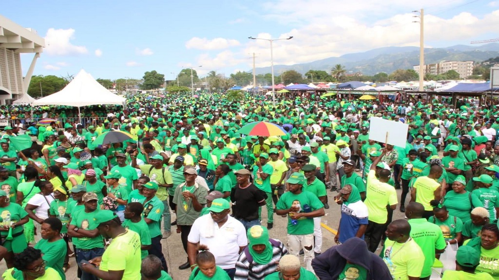 Jamaica Labour Party (JLP) supporters marching into the National Arena complex in St Andrew for Sunday's public session of the party's annual conference.