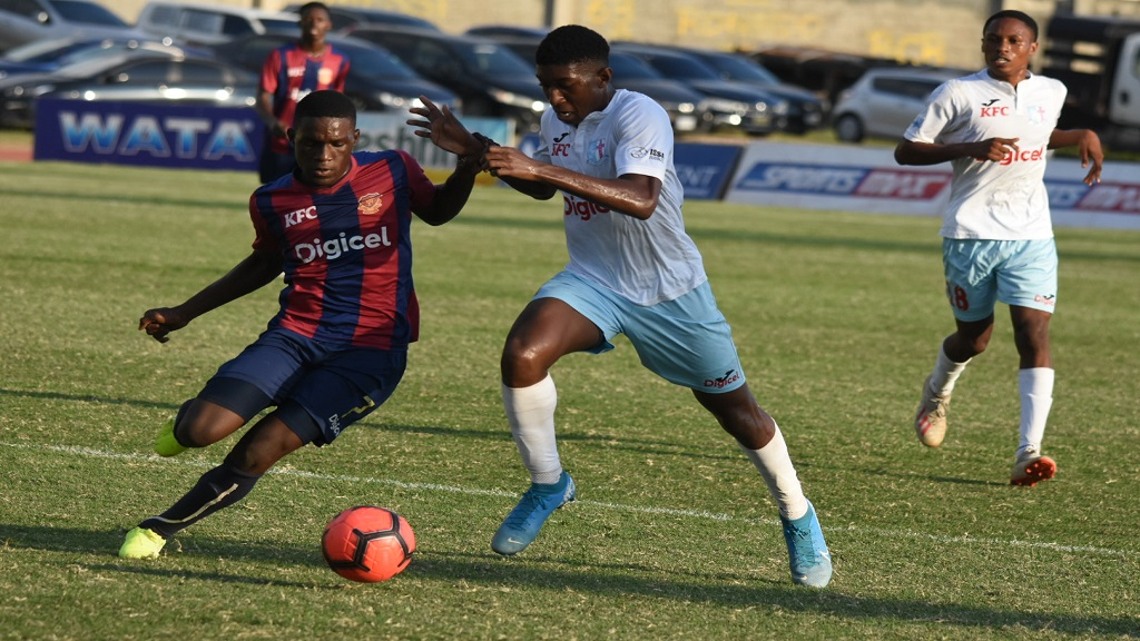 Romario Campbell of St Andrew Technical High School (STATHS) dribbles away from a St George's College defender during their Group H quarter-final round match in the 2019 ISSA/Digicel Manning Cup football competition on Wednesday, November 6. STATHS won 3-1. (PHOTOS: Marlon Reid).